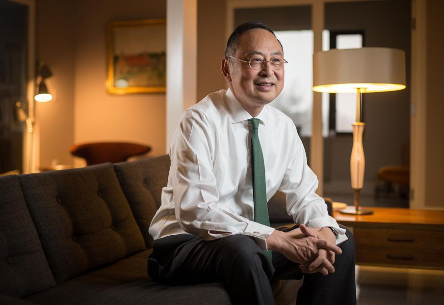 Gerald Chan at his Newton office, which he decorated in part with furniture from eBay.